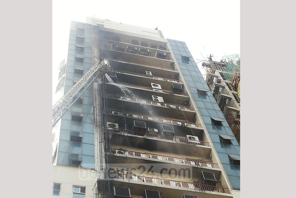 A fire originating from an air-conditioner broke out on the eighth floor of the 20-storey Silver Tower on Wednesday afternoon. No casualties were reported and the extent of damage was not huge as the firefighters doused the fire within a short time. Photo: Mahmud Zaman Ovi