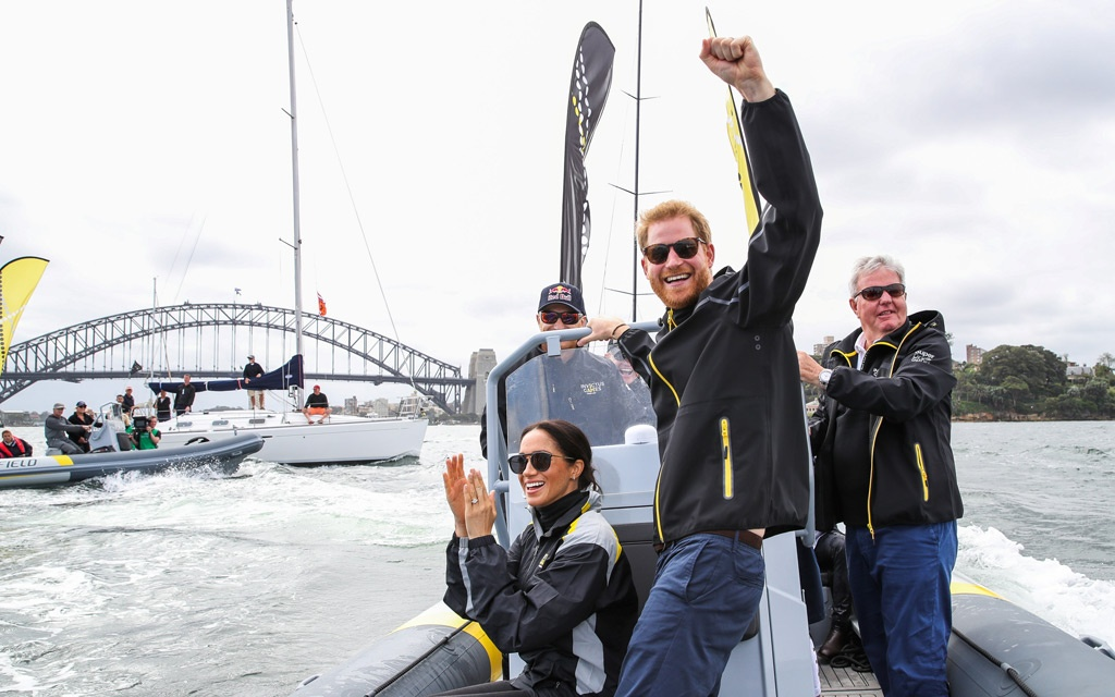 Prince Harry, Duke of Sussex and Meghan, Duchess of Sussex cheer on sailers on Sydney harbour during day two of the Invictus Games Sydney 2018 at Sydney Olympic Park in Sydney, Australia, October 21, 2018. Chris Jackson/Pool via REUTERS