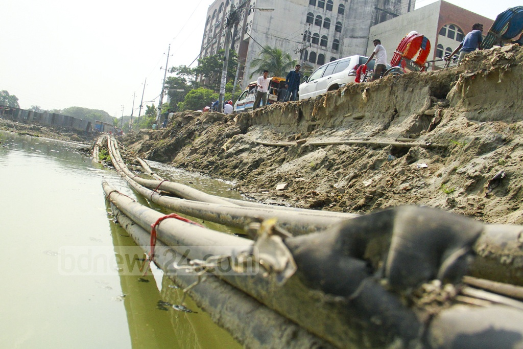 An underground electric line is damaged due to road repair work in Dhaka's Agargaon, which the authorities say have put supply to Parliament Building and adjacent areas in risk. This photo was taken on Thursday.