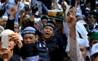 Indonesian Muslims shout slogans during a protest against the burning of a flag bearing an Islamic tenet by members of the country's biggest Muslim organisation in Jakarta, Indonesia Oct 26, 2018. REUTERS