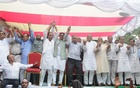 Leaders of the Jatiya Oikya Front link hands in a show of unity in a rally at Chattogram's Kazir Dewri on Saturday.