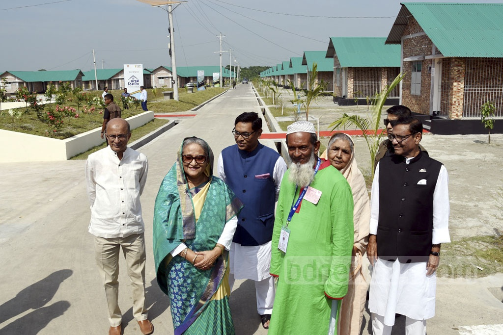 Prime Minister Sheikh Hasina visits a rehabilitation centre constructed for the families affected by land acquisition for the Payra Thermal Power Plant in Patuakhali.