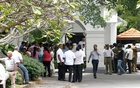 Supporters of sacked Prime Minister Ranil Wickremesinghe wait outside the Prime Minister official residence in Colombo, Sri Lanka Oct 28, 2018. REUTERS