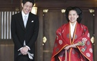 Japanese Princess Ayako (R) and her husband Kei Moriya answer reporters' questions after their wedding ceremony at the Meiji Shrine in Tokyo, Japan, in this photo released by Kyodo on Oct 29, 2018. Kyodo/via REUTERS