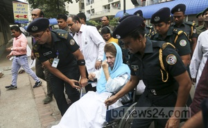 BNP Chairperson Khaleda Zia wipes away tears while being taken for tests at BSMMU's Anatomy Department. Photo: Mahmud Zaman Ovi
