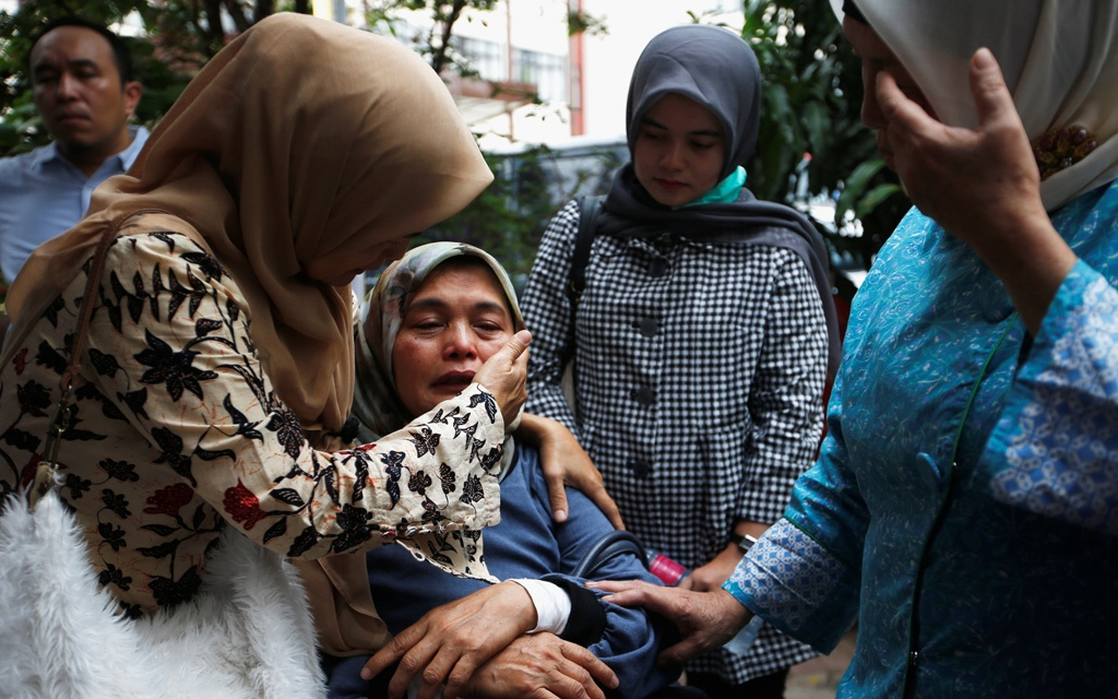 People, who are relatives of passengers on the crashed Lion Air flight JT610, cry at Bhayangkara R. Said Sukanto hospital in Jakarta, Indonesia, October 30, 2018. REUTERS