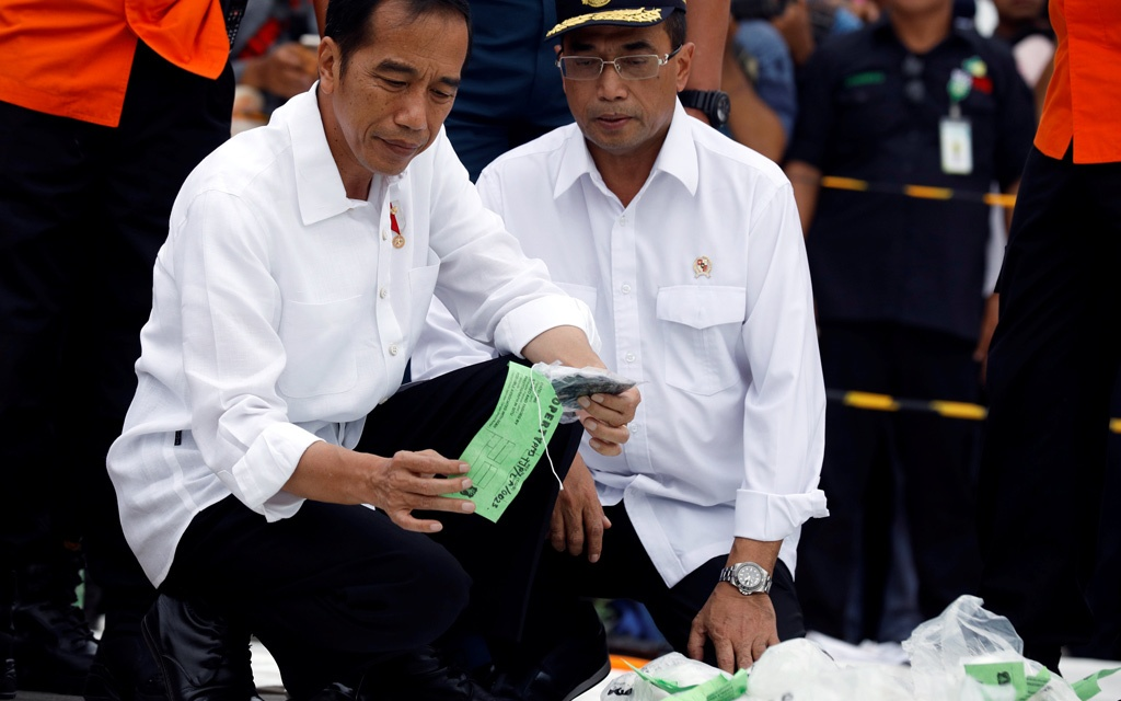 Indonesia's President Joko Widodo inspects the recovered belongings of passengers of Lion Air flight JT610 at Tanjung Priok port in Jakarta, Indonesia, October 30, 2018. REUTERS