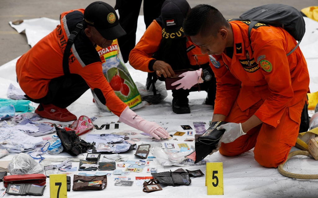 Rescue workers lay out recovered belongings believed to be from the crashed Lion Air flight JT610 at Tanjung Priok port in Jakarta, Indonesia, October 30, 2018. REUTERS
