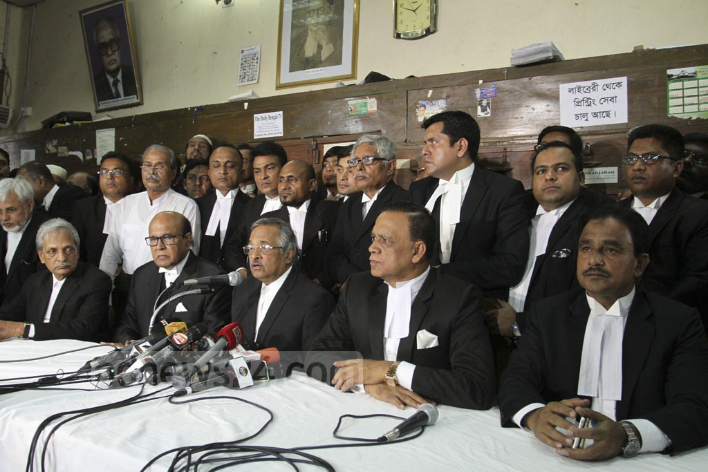 Supreme Court Bar Association President Zainul Abedin speaking at a news conference on Tuesday to protest against the High Court verdict which raised BNP chief Khaleda Zia's jail term to 10 years from five years for graft in Zia Orphanage Trust.