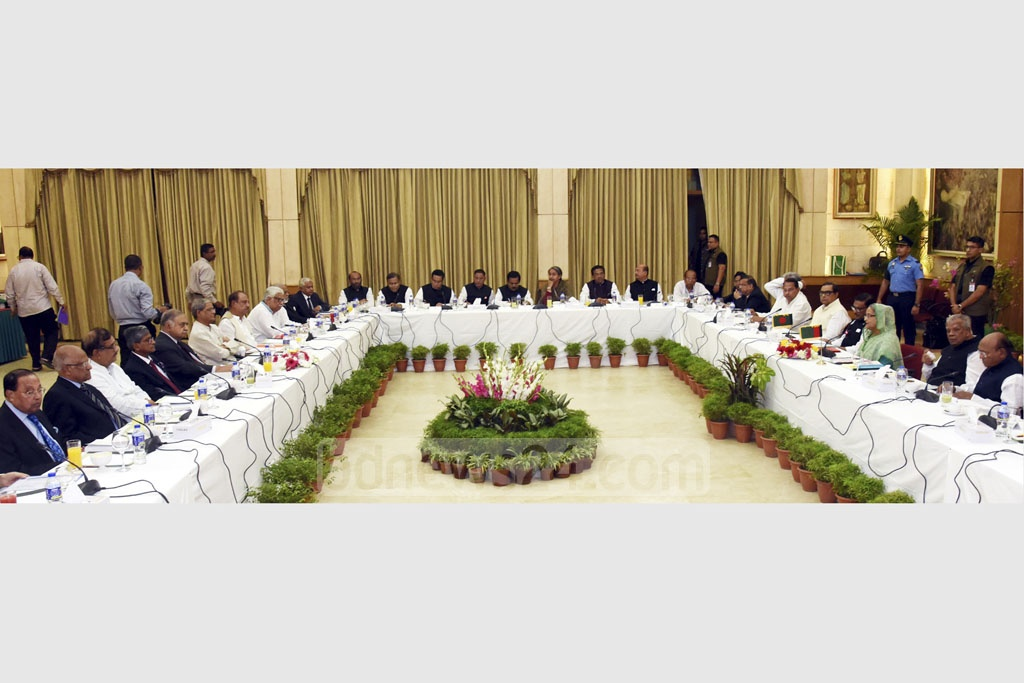 Leaders of the ruling Awami League-led 14-Party coalition and the Jatiya Oikya Front alliance in talks at the Ganabhaban on Thursday . Photo: Saiful Islam Kallol