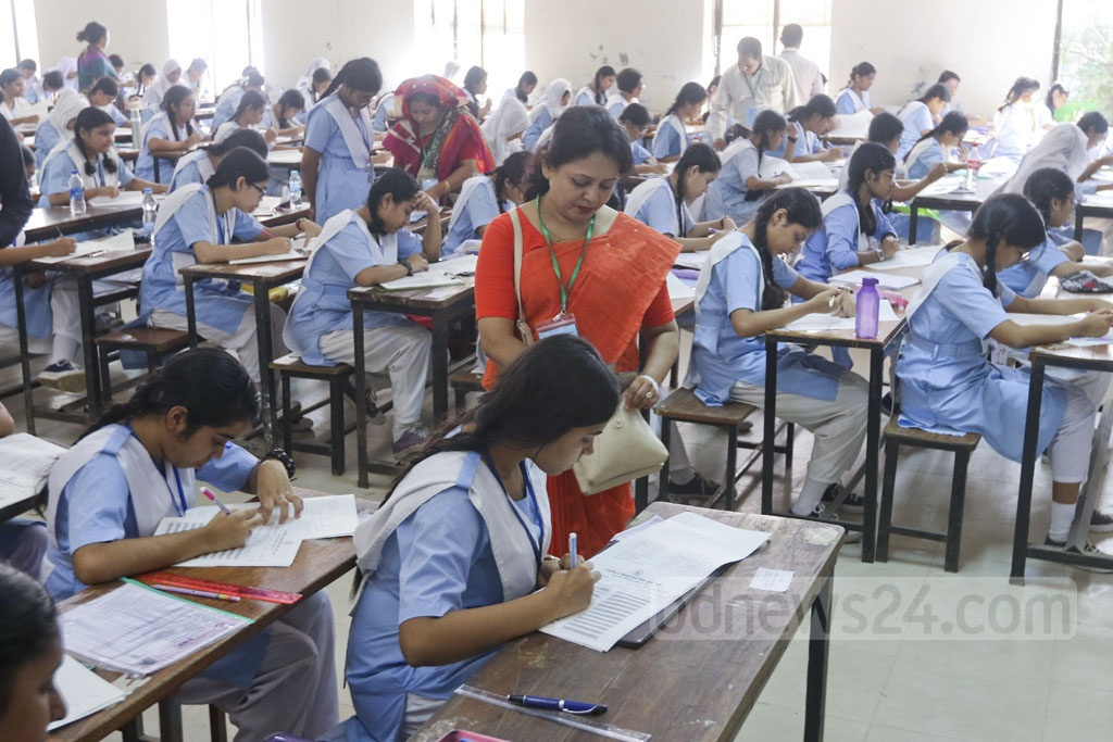 Students at an exam centre in Dhaka's Motijheel Govt Boys' High school on Thursday, the first day of the Junior School Certificate and Junior Dakhil Certificate exams. Photo: Abdullah Al Momin