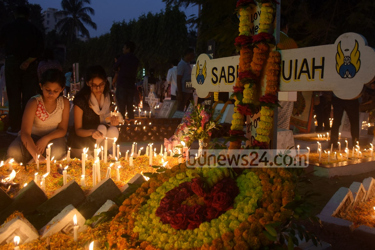 Catholics observe Nov 2 as the All Souls' Day, a day of prayers for the dead. This photo of the observation was taken from the graveyard next to Rani Jopmala Church in Chattogram's Pathorghata on Friday. Photo: Suman Babu
