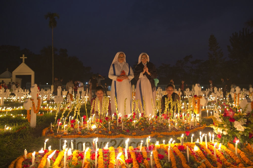 Catholics observe Nov 2 as the All Souls' Day, a day of prayers for the dead. This photo of the observation was taken from the graveyard next to Saint John's Church in Gazipur's Tumulia on Friday. Photo: Mostafigur Rahman