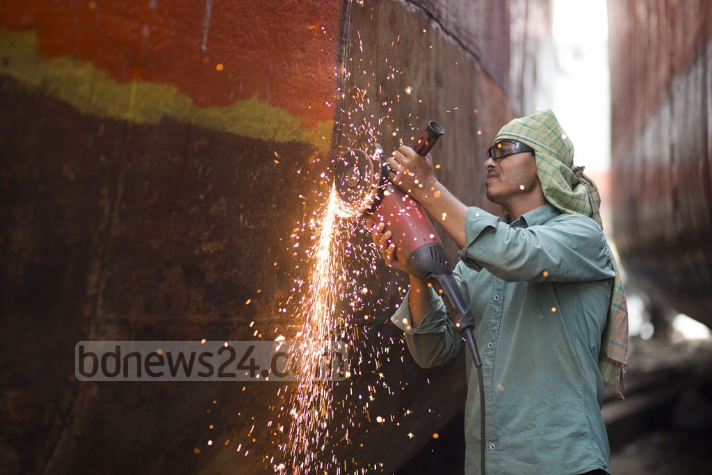 A worker is busy repairing a ship in a dockyard in Dhaka's South Keraniganj. Photo: Mostafigur Rahman