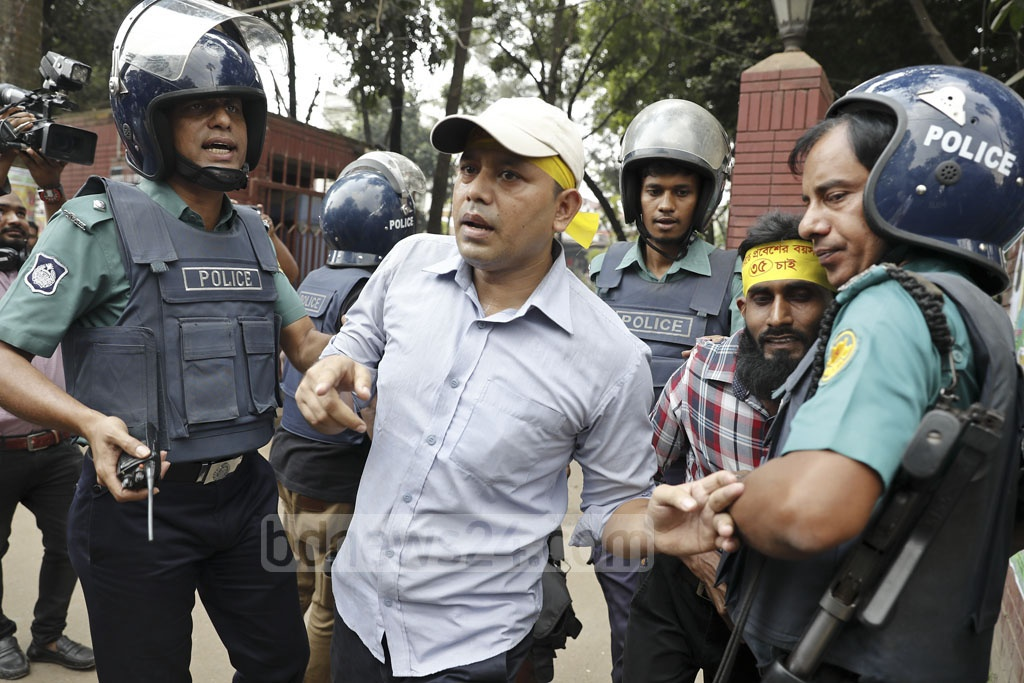Police break up the protesters who rallied for an increase in the age limit for government job applications to 35 in Dhaka on Saturday.