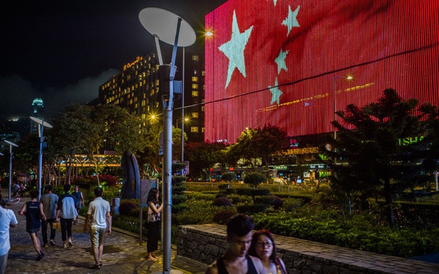 A Chinese flag on an electronic billboard in Hong Kong, Jun 25, 2017. The New York Times