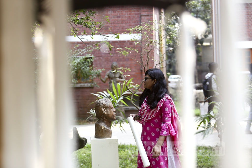 Guests visit a sculpture exhibition to commemorate the 86th birthday of Prof Abdul Razzak, founder of the Dhaka University Department of Sculpture, on Monday. Photo: Mahmud Zaman Ovi