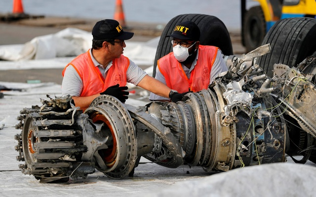 A worker prepares a turbine engine from Lion Air flight JT610 before it is lifted up at Tanjung Priok port in Jakarta, Indonesia, Nov 4, 2018. REUTERS
