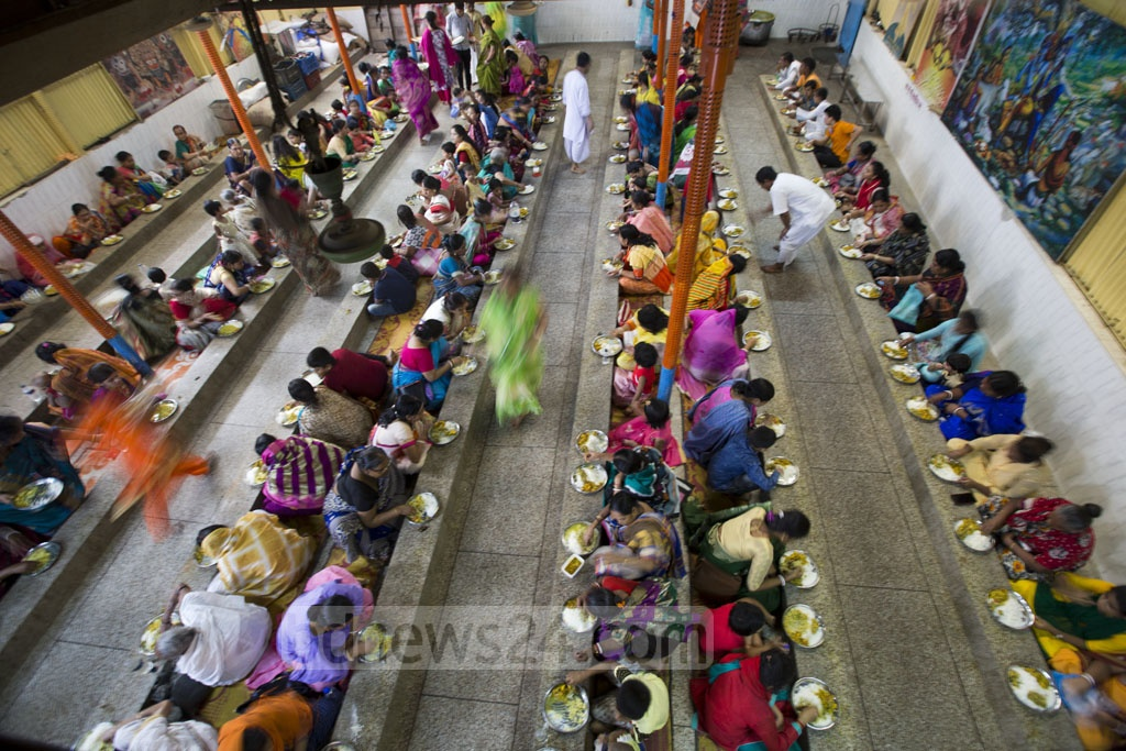 Hindus have food as a ritual during the Annakut festival at the ISKCON Ashram in Dhaka's Swamibagh on Thursday. Photo: Mostafigur Rahman
