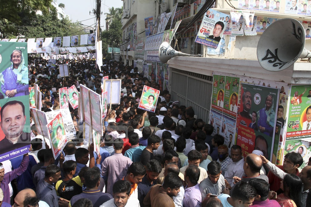 Leaders and activists crowding the Awami League's Dhanmondi office and surrounding areas as the party started selling nomination forms ahead of the Dec 23 general elections.