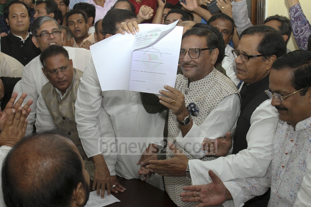 Awami League General Secretary Obaidul Quader collects two nomination forms on behalf of party chief Sheikh Hasina at their Dhanmondi office on Friday ahead of the Dec 23 general elections.