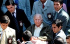 FILE PHOTO: Former leader of the secretive sect Colonia Dignidad, Paul Schaefer (C), sits in a wheelchair outside the Interpol police station after questioning in Santiago, Mar 14, 2005. REUTERS/Eliseo Fernandez//File Photo