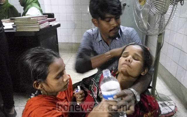Two teenage boys were killed in a road accident in Dhaka's Adabor on Saturday amid clashes between two factions of the Awami League. The mother of one of the victims faints at Dhaka Medical College Hospital after receiving the news of her son's death. Photo: Abdullah Al Momin