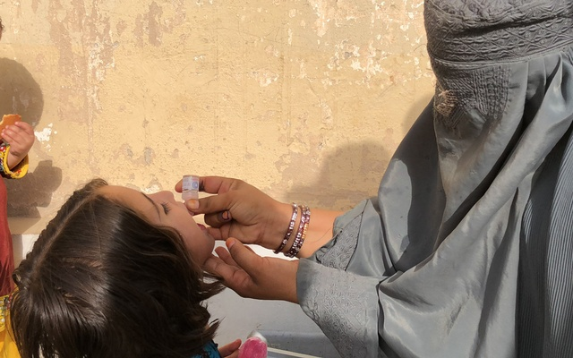 In a photo provided by Fahim Abed, a medical worker administers polio vaccines in the Kandahar province of Afghanistan. Afghanistan is the world's polio capital, but groups of health workers are trying to fix that. The New York Times