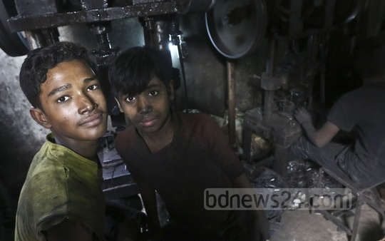 A child labourer makes iron tools amid risky circumstances at a factory in Dhaka's Keraniganj on Monday. Photo: Abdullah Al Momin