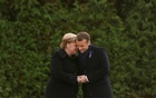French President Emmanuel Macron and German Chancellor Angela Merkel hold hands after unveiling a plaque in the Clairiere of Rethondes during a commemoration ceremony for Armistice Day, 100 years after the end of the First World War, in Compiegne, France, Nov 10, 2018. REUTERS/Philippe Wojazer/Pool