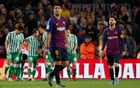 Barcelona's Lionel Messi and Luis Suarez looks dejected as Real Betis' Sergio Canales celebrates scoring their fourth goal with team mates. Football - La Liga Santander - FC Barcelona v Real Betis - Camp Nou, Barcelona, Spain - November 11, 2018. Reuters