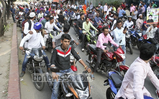 Supporters escorting a prospective aspirant with a procession of motorcycles in a flagrant violation of the electoral code of conduct to the Awami League's Dhanmondi office in Dhaka on Monday. Photo: Asif Mahmud Ove