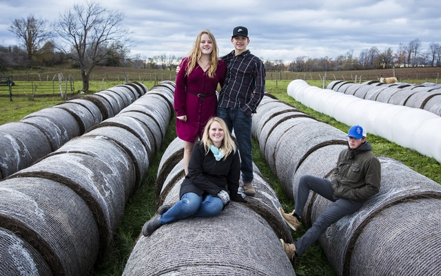 Jenny Hanley, seated, and her daughter Shelby Hanley, left, with Kyle Johnston, center, and Jared Kaye, who all live with Hanley, an addictions counselor, on her family farm near Flesherton, Ontario, Oct. 20, 2018. The New York Times
