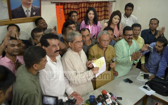 BNP Secretary General Mirza Fakhrul Islam Alamgir collects a party nomination form on behalf of party chief Khaleda Zia for the Feni-1 seat at the party's headquarters in Dhaka's Naya Paltan on Monday. Photo: Abdullah Al Momin
