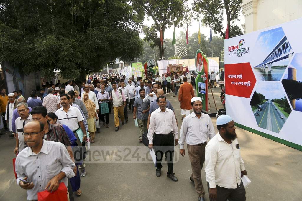 People visit the Income Tax Fair at the Officers' Club in Dhaka on Tuesday. Photo: Mahmud Zaman Ovi