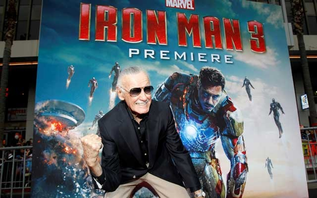 FILE PHOTO: Stan Lee gestures as he poses at the premiere of