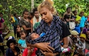 A mother and her baby at a health clinic where polio vaccines were administered to children in Lae, Papua New Guinea, in July. Vaccination rates are down to 30 percent in some parts of the country. The New York Times