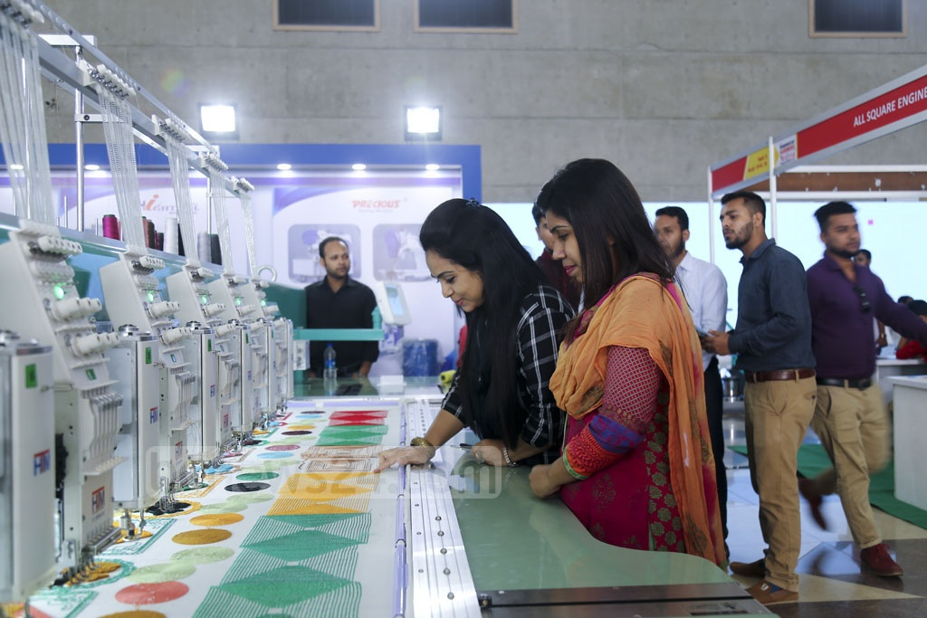 Visitors look around the garment accessories exhibition at International Convention City Bashundhara on the first day on Thursday. Photo: Mahmud Zaman Ovi