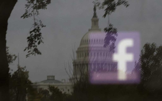 A Facebook logo, seen in reflection on an advertising board near the US Capitol in Washington, Oct 25, 2018. The New York Times