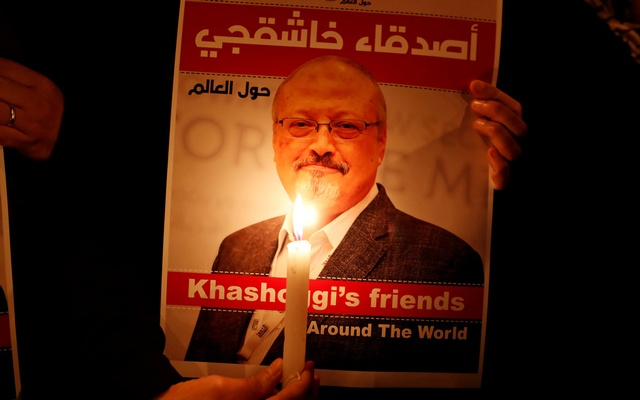 FILE PHOTO: A demonstrator holds a poster with a picture of Saudi journalist Jamal Khashoggi outside the Saudi Arabia consulate in Istanbul, Turkey Oct 25, 2018. REUTERS/Osman Orsal/File Photo