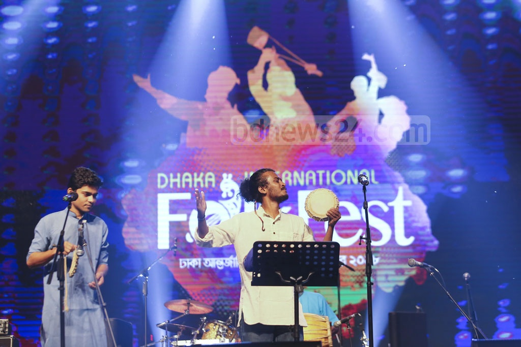 Bangladeshi and foreign artists entertain the audience of Dhaka International FolkFest 2018 at the Army Stadium on the second day of the festival on Friday.