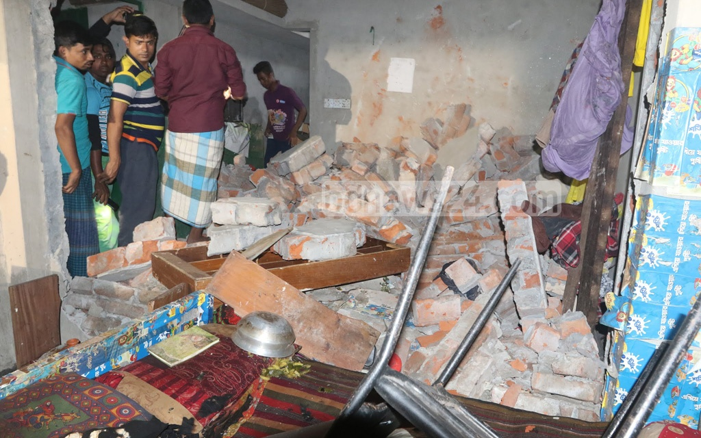 The wall of a house collapses in a gas cylinder explosion in Dhaka's Jatrabari on Friday. Photo: Abdullah Al Momin