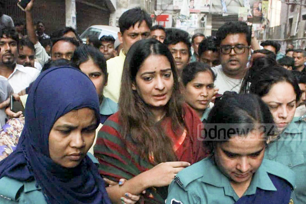 Police escorting BNP leader Nipun Roy Chowdhury to jail on Friday after the Chief Metropolitan Magistrates Court of Dhaka granted the law enforcers five days to grill her and six others in custody over violent clashes at Naya Paltan.