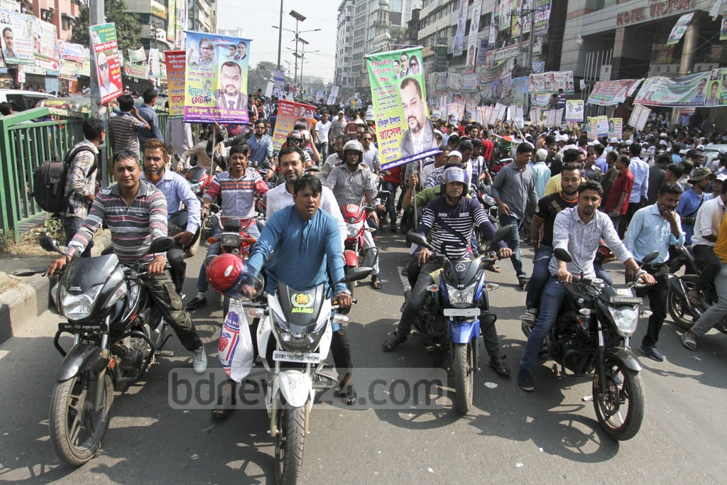 Defying the electoral code of conduct, BNP supporters ride motorcycles to the party's Naya Paltan office in Dhaka on Friday to submit nomination forms for the upcoming parliamentary election. Photo: Asif Mahmud Ove