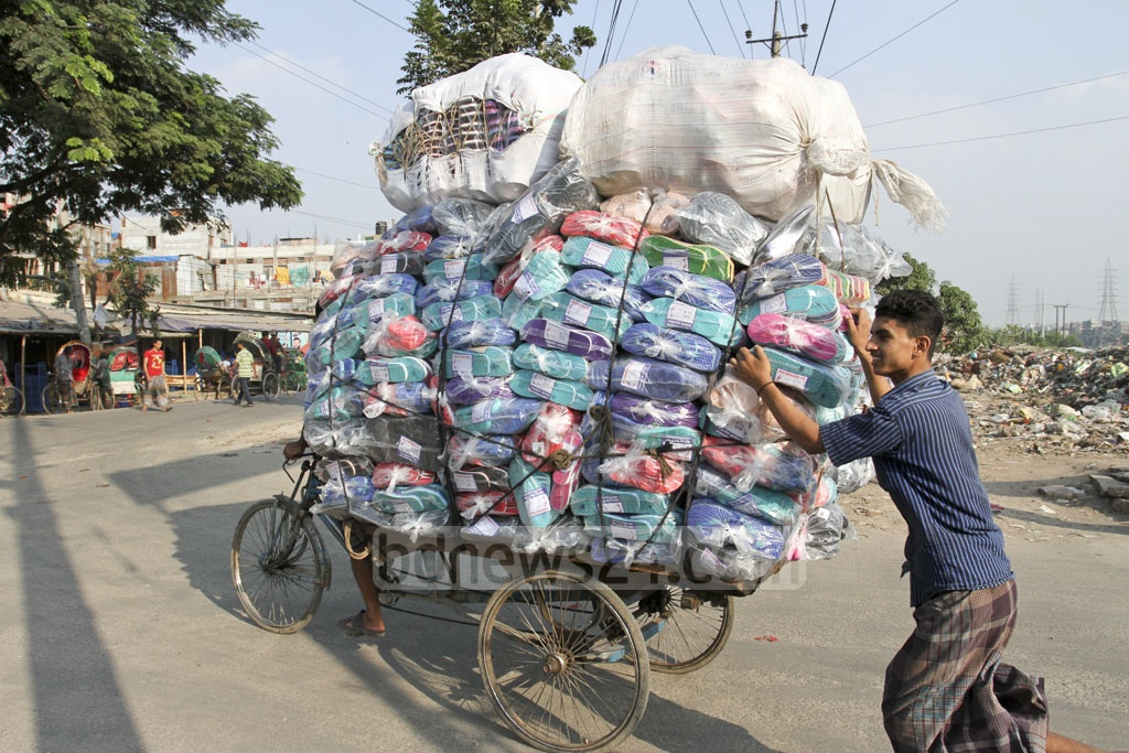A van rickshaw is used to transport sandals for sale from Kamrangirchor to Dhaka city. Photo: Asif Mahmud Ove