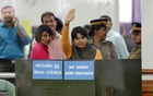 Trupti Desai, a women's rights activist, waves from inside the Cochin International Airport at Kochi, India, November 16, 2018. Reuters