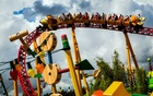 Guests ride a new rollercoaster at the