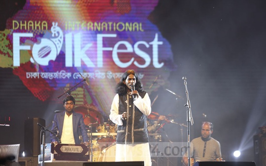Artists perform at the Dhaka International FolkFest at the Army Stadium in Dhaka on Saturday, the concluding day of the three-day event. Photo: Mahmud Zaman Ovi