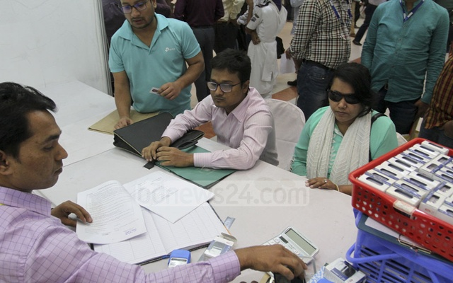 Disabled taxpayers submit the return on Saturday at the income tax show at the Bailey Road Officers Club of the capital. This year's income tax fair has a separate booth for people with disabilities. Photo: Asif Mahmud