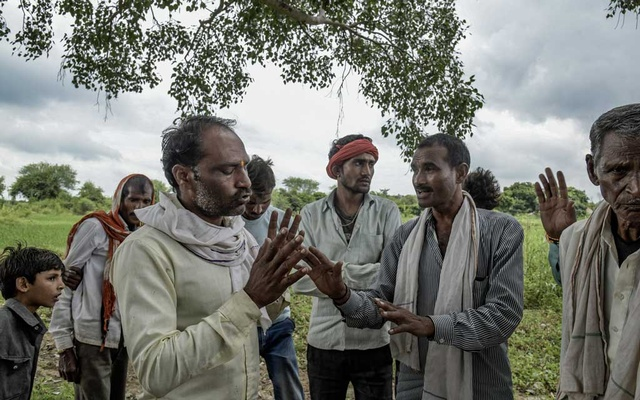 An upper-caste Gujjar man, left, argues with Dalit people, a class of Indians who are not just considered lower caste, but technically outcaste, near the village's temple where Dalits are not allowed to sit, in the village of Thati, India, Sep 21, 2018. The New York Times